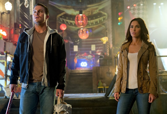 Stephen Amell and Megan Fox as Casey Jones and April O'Neil