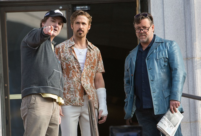 Shane Black, Ryan Gosling and Russell Crowe on the set of The Nice Guys