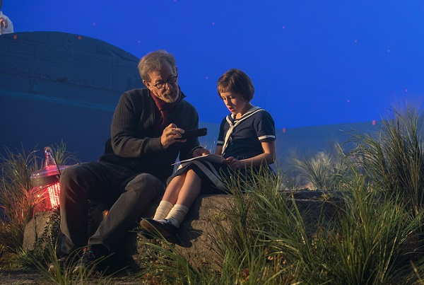 Director Steven Spielberg and Ruby Barnhill on the set of The BFG