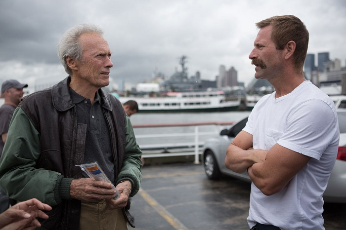 Clint Eastwood with Aaron Eckhart (who plays Sully's co-pilot, Jeff Skiles) on the set of Sully