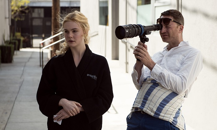 Elle Fanning and Nicolas Winding Refn on the set of The Neon Demon
